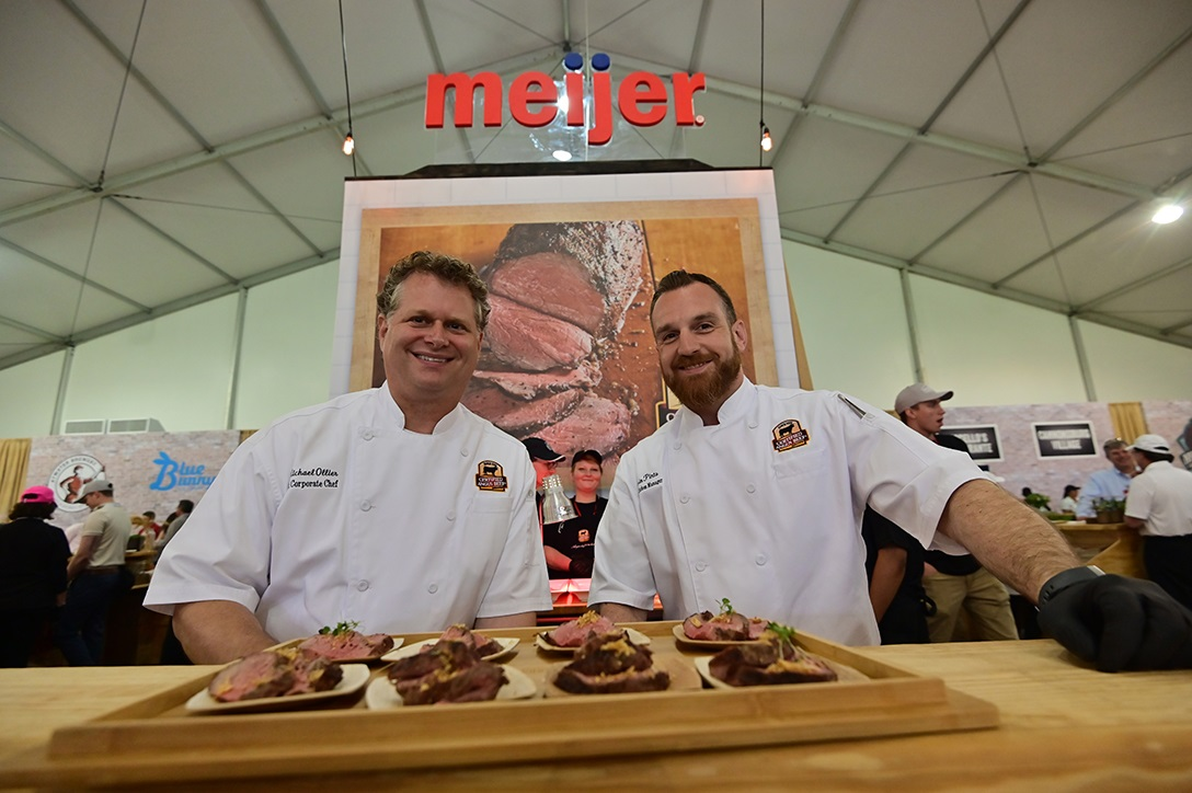 Chefs showing off culinary delights at the Grand Taste