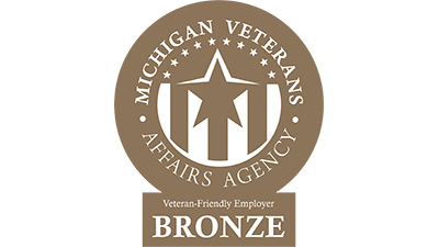 "A bronze logo with a star and stripes that reads ""Michigan Veterans Affairs Agency Veteran Friendly Employer"""