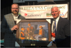 Michael Norkus receiving a gift for the 2018 International Hunter Education Association-USA (IHEA-USA) Volunteer Instructor of the Year Award