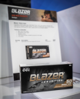 Box of Blazer ammunition in front of a product data sheet for Blazer