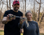 Lee and Tiffany Lakosky holding boxes of Federal TTS turkey loads.