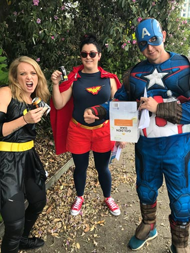 "Superheroes protecting the environment: a team of volunteers in Australia completing one of the tasks in the ""amazing race"""