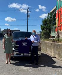 Image - Executive Director of YES Shelter Meagan Hennekam and Hydro One's Chief Corporate Affairs and Customer Care Officer Jason Fitzsimmons in front of YES Shelter's new truck.