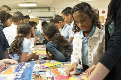 Students at Cleveland Elementary School in Allentown, Pa., select their summer reading books from PPL.
