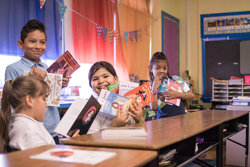 Students at Cleveland Elementary School in Allentown, Pa., show their enthusiasm for the books they selected through the PPL Cover to Cover program.