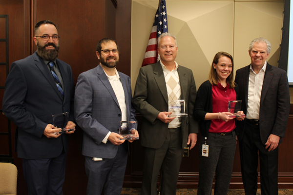 President and CEO Bill Spence and Peer-to-Peer Award Winners, Kevin Steinbacher, Matt Henry, Rob Hodge and Emily Haelsig