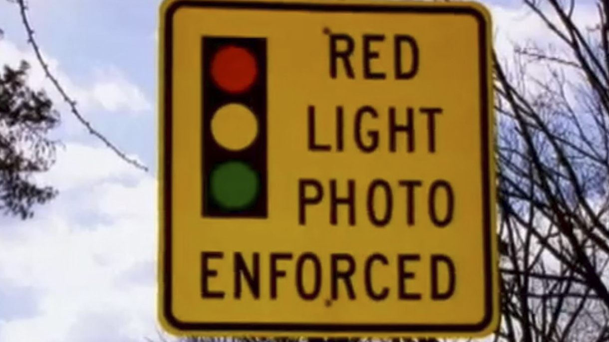 Enforcement signs and traffic signals