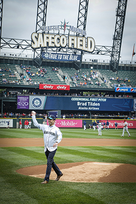 Alaska CEO Brad Tilden throws the first pitch at the Seattle Mariners game on June 28, 2017