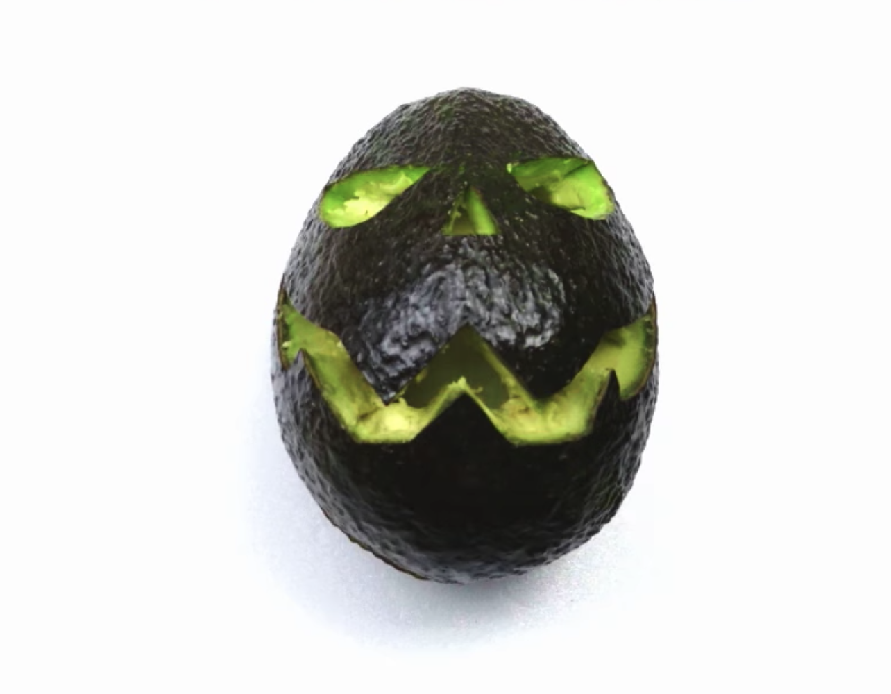 Forget Pumpkins: Here's How To Turn An Avocado Into A Jack-O'-Lantern