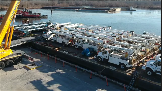 Barge containing Dominion Energy trucks leaves Charles City, VA heading to Puerto Rico