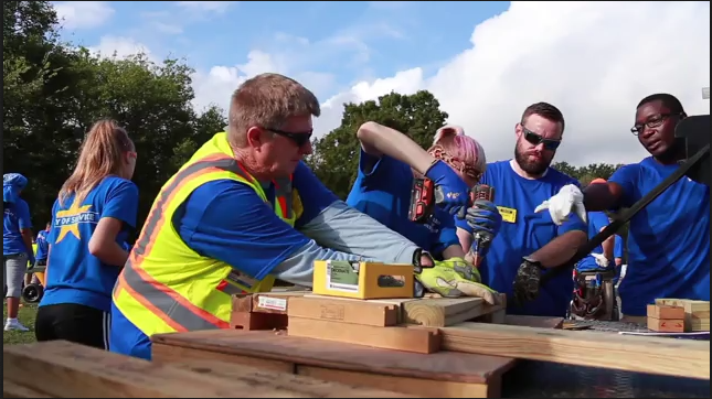 James Monroe High student helps build benches with Dominion Energy volunteers
