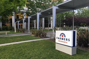 Farmer's Insurance sign in front of building