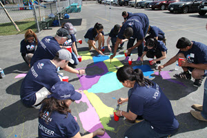Volunteers painting on the street