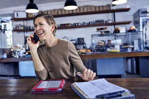 Woman on cell phone in bakery