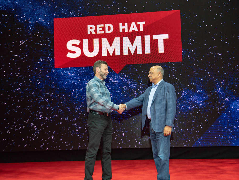 Paul Cormier, Executive Vice President, and President Products and Technologies, Red Hat, and Arvind Krishna, Senior Vice President, IBM Hybrid Cloud, at Red Hat Summit 2018 in San Francisco on May 7, 2018. (Credit: Red Hat)