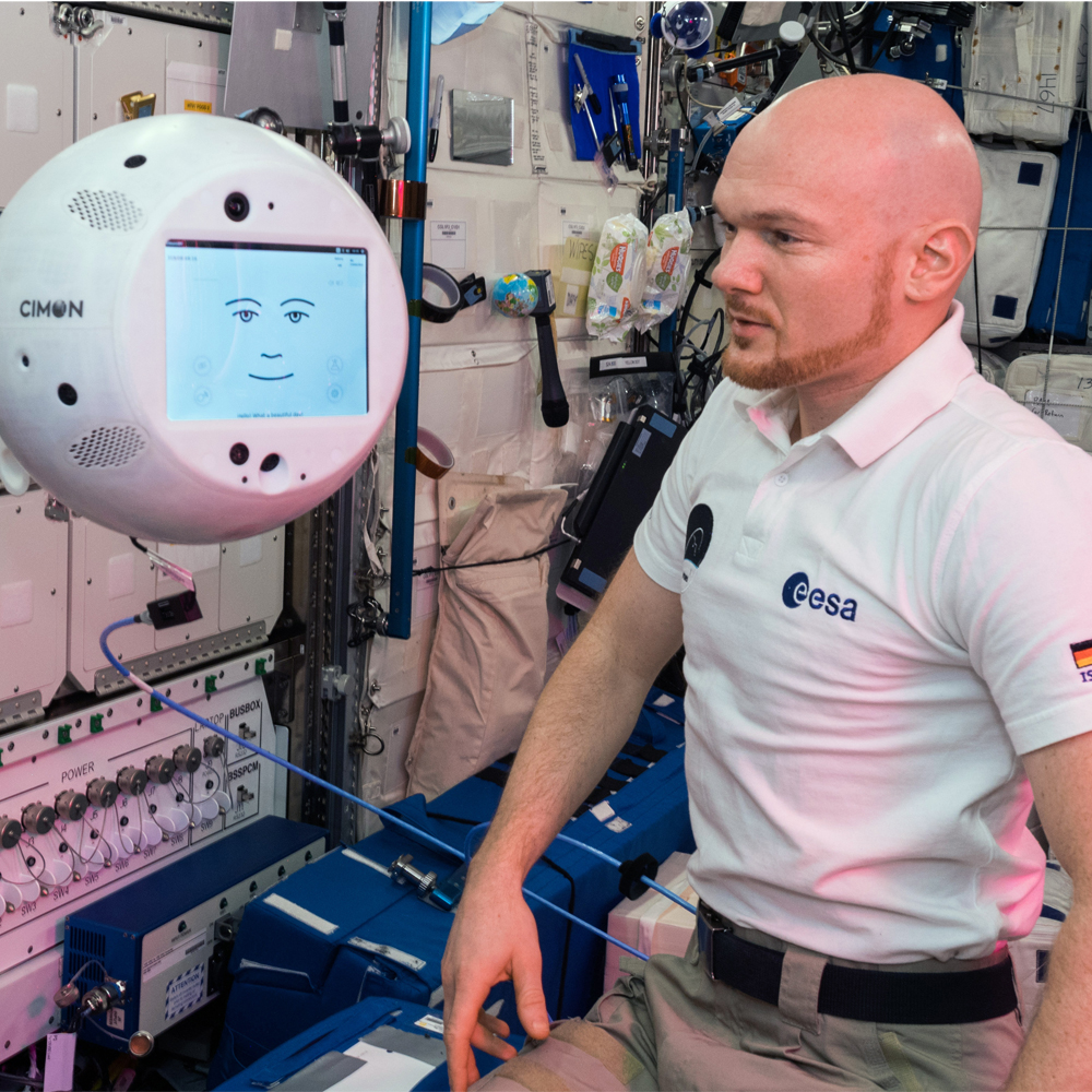German ESA astronaut Alexander Gerst instructs CIMON, an AI-enabled astronaut assistant, aboard the International Space Station. (Photo credit: DLR