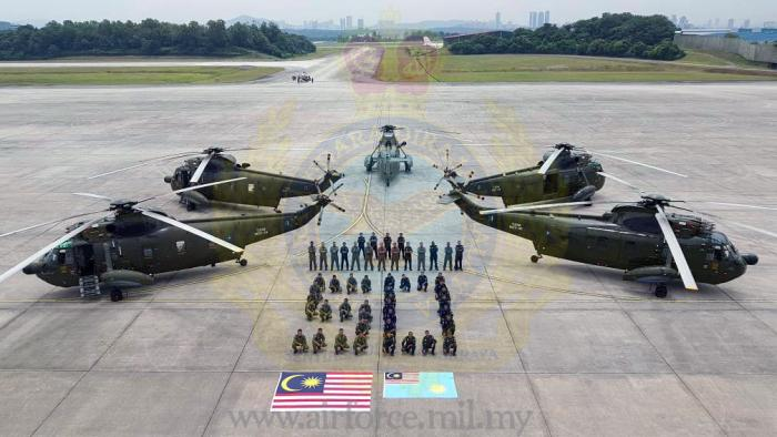 Sikorsky Nuri S-61 pilots and crew with the aircraft in RMAF livery