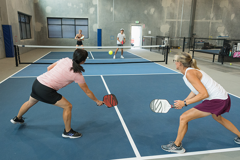 Two women playing pickle ball