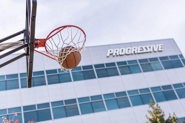 Basketball going through hoop outside of Progressive building