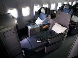 Two blue Business Class airplane seats.