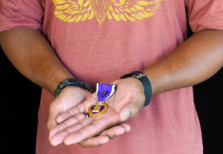Wounded warrior Michael Matthews (Army), with Purple Heart award.