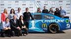 Credit One Bank pose in front of the NASCAR #1 car with Jamie McMurray