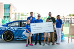 Credit One Bank and Kyle Larson with a donation to Meeting Street Academy