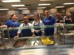 Credit One employees volunteer at a soup kitchen in the community