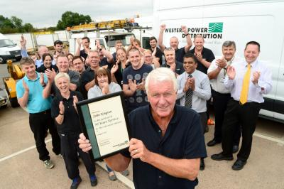 •	John Kington is congratulated for his 50 years' service by his team-mates.