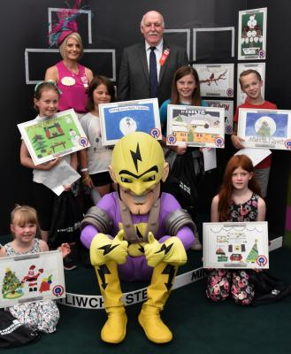 Brecon Pupils from Mount Street Junior School, Llanwrtyd Wells are pictured receiving their prizes from Royal Welsh Lady Ambassador Georgina Cornock-Evans and WPD's Phil Davies and Superhero Pylonman.