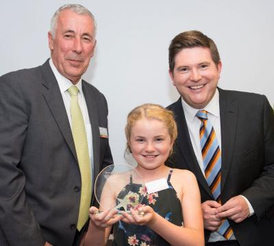 Megan Crombie-Davies, winner of the Tenovus Young Volunteer Award, is pictured with WPD's Distribution Manager Ian Lawrence (left) and ITV presenter and Patron of the charity, Carl Edwards.