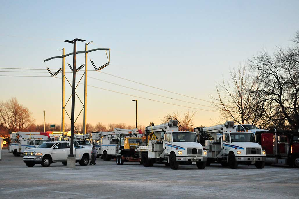 PPL Electric Utilities bucket trucks lined up in staging area