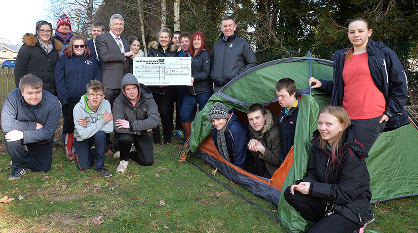 Students from Powys county in the U.K pose with a check from WPD, intended to help students participate in the DofE program